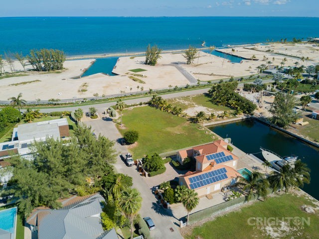 Crystal Harbour Canal Lot For Sale, 411082, West Bay Beach North Properties For Sale Property